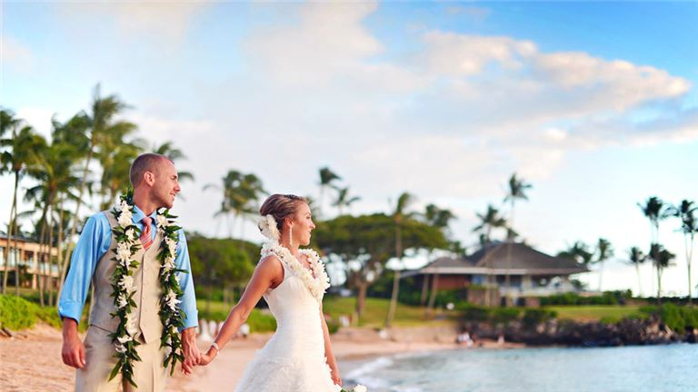 Photo of a jsut married couple on the beach for a Hawaii Wedding Planning and Coordination Company HI, featured listing on behalf of Island Business and Commercial Brokerage